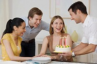 Woman celebrating birthday with friends