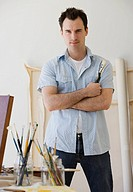 Male artist in painting studio