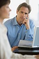 Businessman next to laptop