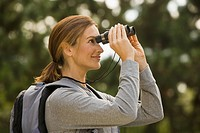 Woman looking through binoculars