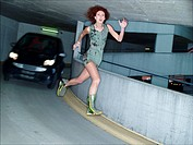 Woman running in underground parking