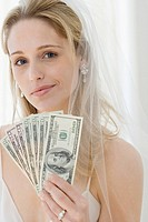 Portrait of bride holding money