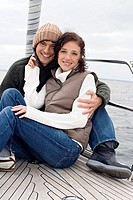 Germany, Baltic Sea, Lübecker Bucht, Young couple on sailing boat, smiling