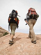 People hiking with backpacks