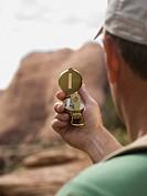 Man looking at compass