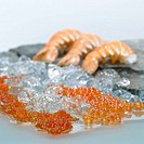 Shrimps and caviar on crushed ice