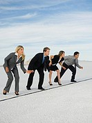 Businesspeople at starting line for race, Salt Flats, Utah, United States