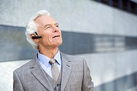 Germany,Baden Württemberg, Stuttgart, Senior Business man wearing headset