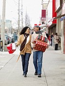 African couple carrying Christmas presents