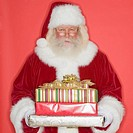 Santa Claus holding stack of gifts
