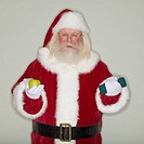 Santa Claus holding apple and dumbbell
