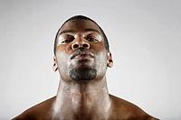 Serious African man sweating