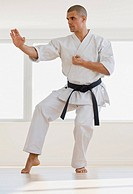 Hispanic male karate black belt in fighting stance