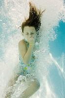 Girl plugging nose underwater