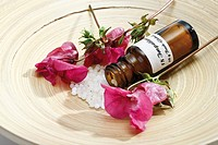 Bottle with Bach Flower Stock Remedy, Impatiens on wooden plate