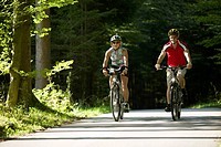 Germany, Bavaria, Tegernsee, Couple mountain biking