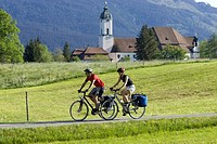 Germany, Bavaria, Couple mountain biking across highway