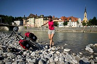 Germany, Bavaria, Bad Toelz, Woman fooling about on shore