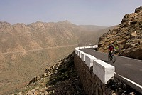 Spain, The Canary Islands, Man mountain biking across serpentines
