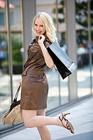 Young woman going shopping, smiling