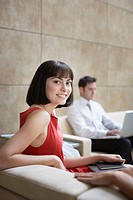 Businesswoman sitting in office lobby