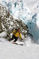 Backcountry skier skiing in the Chugach Mountains in Twentymile Valley, Alaska