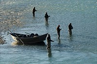Group of fishermen sport fishing on the Kenai River near Cooper Landing, Alaska