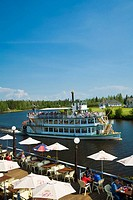 People dine at Chena Pumphouse restaurant as the Riverboat Discovery go by in Fairbanks, Alaska