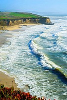 Golfers on the corse along the Pacific Ocean near Half Moon Bay, California, USA