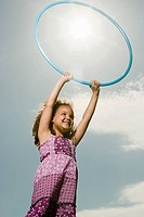 Girl with a plastic hoop