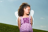 Girl wearing angel wings (thumbnail)