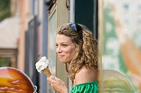 A young woman holding an icecream