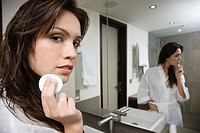 A young woman removing make up (thumbnail)