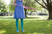 Woman playing with a hula hoop