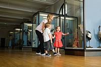 Mother and children looking at a museum exhibit (thumbnail)