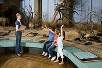 Children and a teacher at a museum