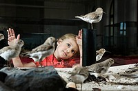 Girl looking at stuffed birds in museum