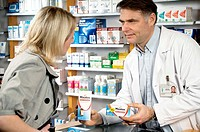 INTERIOR OF A CHEMIST´S SHOP Models. Maalox in drinkable solution or tablet. Drug used against gastric acidity.