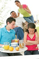 CHILD EATING BREAKFAST Models. Brother and sister 16_year_old and 8_year_old.