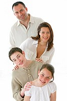 FAMILY INDOORS Models. Brother and sister aged respectively 16_year_old and 8_year_old with their parents.