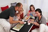 Models. Board game in family.