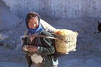 ASIAN WOMAN Winter trekking at the village Tingri near the southern frontier of Tibet and the norther frontier of Nepal at the monastery Rongbuk at th...