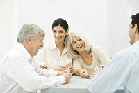 Family playing cards, laughing