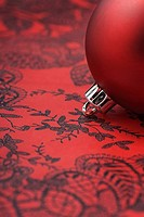 Red Christmas tree ornament, detail