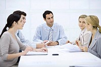 Businessman sitting with colleagues at conference table