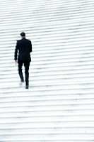 Businessman ascending stairs outdoors