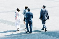 Pedestrians walking across public square