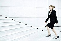 Businesswoman ascending steps