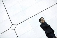 Businesswoman using cell phone (thumbnail)
