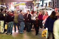 Crowd scene on sidewalk near bus stop on Broadway in New York City looking north at Times Square (thumbnail)